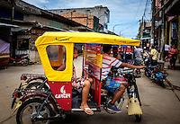 NAUTA, PERU - CIRCA OCTOBER 2015:  Typical motorbike, ricksaw in the streets of Nauta in the Peruvian Amazon