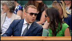 Great Britain's Olympians Sir Chris Hoy and his wife  in the royal box at The Wimbledon Tennis Championships<br /> The All England Lawn Tennis Club, Wimbledon, United Kingdom<br /> Saturday, 29th June 2013<br /> Picture by Andrew Parsons / i-Images