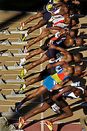 Sprinters make their way off the blocks in the 100 meter dash. Maurice Green is the favorite in the race.