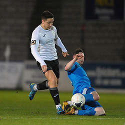 TELFORD COPYRIGHT MIKE SHERIDAN Adam Walker of Telford is tackled during the FA Trophy Round 1 fixture between AFC Telford United and Leamington at the New Bucks head Stadium on Tuesday, December 17, 2019.<br /> <br /> Picture credit: Mike Sheridan/Ultrapress<br /> <br /> MS201920-034