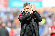 Manchester United Manager, Ole Gunnar Solskjaer applauds the Manchester United fans after the Premier League match between Huddersfield Town and Manchester United at the John Smiths Stadium, Huddersfield, England on 5 May 2019.