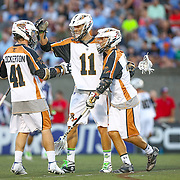 Joel White #11 of the Rochester Rattlers celebrates a goal with Mark Cockerton #41 of the Rochester Rattlers during the game at Harvard Stadium on August 9, 2014 in Boston, Massachusetts. (Photo by Elan Kawesch)