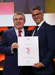 LIMA, Sept. 14, 2017  International Olympic Committee (IOC) President Thomas Bach (L) poses with Casey Wasserman, Chairman of LA 2028, after sign the contract during the presentation and announcement ceremony of the 2024 and 2028 Summer Olympic Games at the 131st IOC session in Lima, Peru, on Sept. 13, 2017. The IOC makes historic decision by simultaneously awarding Olympic Games 2024 to Paris and 2028 to Los Angeles on wednesday. (Credit Image: © Li Ming/Xinhua via ZUMA Wire)