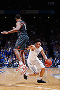 LEXINGTON, KY - DECEMBER 5: Devin Booker #1 of the Kentucky Wildcats fakes a shot against Demarcus Holland #2 of the Texas Longhorns during the game at Rupp Arena on December 5, 2014 in Lexington, Kentucky. The Wildcats defeated the Longhorns 63-51. (Photo by Joe Robbins)