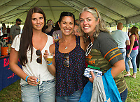 Kendra Devivo, Ashley Bezskosa and Angela Marsh sample a Stoneface Brew at Gunstock Mountain's Brew and BBQ Fest on Saturday afternoon.  (Karen Bobotas/for the Laconia Daily Sun)