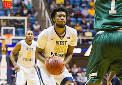 Nov 28, 2016; Morgantown, WV, USA; West Virginia Mountaineers forward Brandon Watkins (20) shoots in the lane during the first half against the Manhattan Jaspers at WVU Coliseum. Mandatory Credit: Ben Queen-USA TODAY Sports