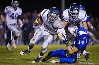 Lake City High's Colton Carlson is dragged down by his jersey by Carlos Martinez from Coeur d'Alene High during the first half. Dylan Eastin from Lake City, right, comes in to break up the tackle.