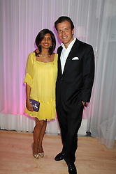 JOEL CADBURY and his wife DIVIA at the Lauren-Perrier 'Pop Art' Pink Party in aid of Capital 95.8's Help A London Child, held at Suka at the Sanderson Hotel, 50 Berners Street, London W1 on 25th April 2007.<br />