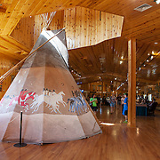 Visitor center at the  Crazy Horse Memorial, a monument under construction on Thunderhead Mountain, a privately held land in the Black Hills, Custer County, South Dakota. It depicts Crazy Horse, an Oglala Lakota warrior, riding a horse and pointing into the distance. The memorial was commissioned by Henry Standing Bear, a Lakota elder, to be sculpted by Korczak Ziolkowski. Photography by Jose More