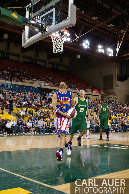 April 30th, 2010 - Anchorage, Alaska: Handles Franklin (14) of the Harlem Globetrotters makes a happy mistake as he attempts to make a reverse ally-oop pass over the backboard that turned into a trick shot that went right in the hoop Friday night at the Sullivan Arena.