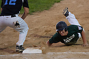 West Deptford's Ed Essig dives back to first on a pick off attempt during the opening round of the Mid-Atlantic Senior League regional tournament held in West Deptford on Friday, August 5.