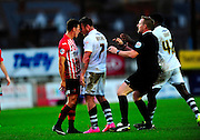 Exeter City's Lee Holmes and Port Vale's Chris Birchall knock heads during the The FA Cup match between Exeter City and Port Vale at St James' Park, Exeter, England on 6 December 2015. Photo by Graham Hunt.