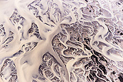 Tungnaa river winds its way through the sandy plains a short distance form Snjooldufjallgardur inthe Fjallabak Nature Reserve. From the air the milky glacial water resembles nothing more than a web of capillaries.