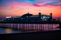 © Licensed to London News Pictures. 05/12/2016. Brighton, UK. Brighton Palace Pier stands silhouetted against a colourful sunset in Brighton. Photo credit: Hugo Michiels/LNP
