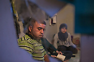 Syrian refugee Rafaat Al Mousa, who in September 2013 found his wife and 4-year-old son dead in his then-employer's irrigation pool, takes a moment to compose himself at his home in Damour, Lebanon on Friday, June 6, 2014. <br /> <br /> Although Rafaat initially alleged that his wife and son were murdered, he was coerced to recant days later, then was forced to flee Lebanon in less than a year he and his family had fled Syria.<br /> <br /> Rafaat and his family escaped Syria in June 2013 and settled in the Beirut coastal town of Damour. There they found work on a banana plantation. Their new employer also rented the family a hut on the property.<br /> <br /> On September 2, 2013, Rafaat and his children were working on the plantation when Rafaat sent one of his boys home to check on Yusra, his wife and mother to his children. Yursa, according to Rafaat, was in their hut, some 200-meters from where they were on the plantation, caring for his youngest son, a 4-year-old with Cerebral Palsy. <br /> <br /> Moments later, the boy who went to check on his mother and young brother returned to his father, visibly shaken and in tears. He told Rafaat that he found their hut ransacked before being ushered away by their employer/landlord, who told to boy that neither his mother nor baby brother were around.