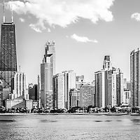 Chicago skyline panoramic picture of the Chicago Gold Coast and Hancock Building in black and white. The Chicago Gold Coast is part of the Chicago Near North Side in Chicago. The John Hancock Center Building is a famous part of the Chicago skyline and is one of the tallest skyscrapers in the world. Panoramic photo ratio is 1:3.