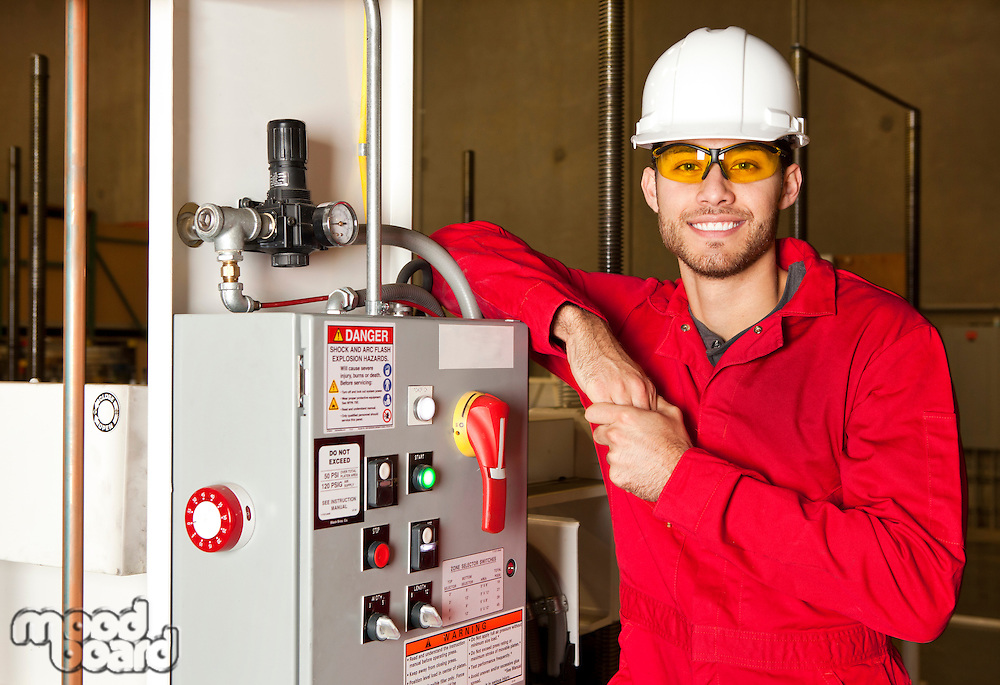 Technician standing next to electrical unit