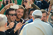 April 12, 2017 : Pope Francis is greeted by young people as he arrives to lead the weekly general audience in St. Peter's Square at the Vatican. Antoine Mekary | Aleteia | I.Media