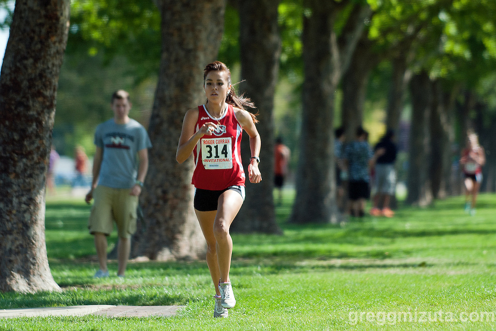 Northwest Nazarene University senior Natalie Evans during the Roger Curran 4k collegiate race at West Park in Nampa, Idaho on September 14, 2013.<br /> <br /> Jordan Powell finished first (14:49.71) followed by Northwest Nazarene University's Natalie Evans (15:13.75), Susanna Fleming (15:36.62), Hailey Bradshaw (16:05.63), and Jaydn Gourley (16:14.57).