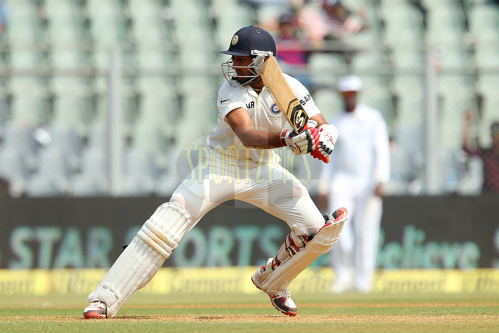 Cheteshwar Pujara of India  during day two of the second Star Sports test match between India and The West Indies held at The Wankhede Stadium in Mumbai, India on the 15th November 2013<br /> <br /> This test match is the 200th test match for Sachin Tendulkar and his last for India.  After a career spanning more than 24yrs Sachin is retiring from cricket and this test match is his last appearance on the field of play.<br /> <br /> <br /> Photo by: Ron Gaunt - BCCI - SPORTZPICS<br /> <br /> Use of this image is subject to the terms and conditions as outlined by the BCCI. These terms can be found by following this link:<br /> <br /> http://sportzpics.photoshelter.com/gallery/BCCI-Image-Terms/G0000ahUVIIEBQ84/C0000whs75.ajndY