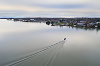 https://Duncan.co/boat-approaching-the-shore-at-gananoque