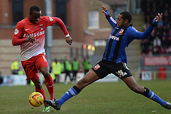 Orient's Moses Odubajo and Swindon's Jamie Reckord   compete for the ball - Photo mandatory by-line: Mitchell Gunn/JMP - Tel: Mobile: 07966 386802 22/02/2014 - SPORT - FOOTBALL - Brisbane Road - Leyton - Leyton Orient V Swindon Town - League One