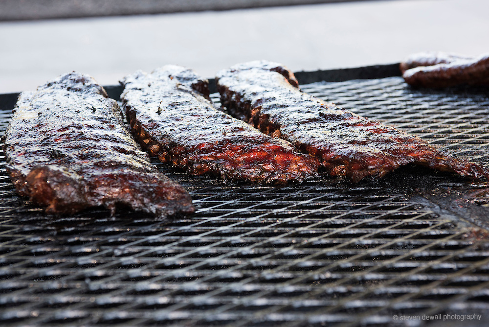 Ribs being cooked in a BBQ Smoker.