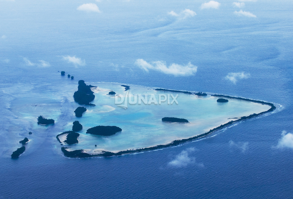 "I call these the ""Headhunter Islands"", for lack of a better name. These are the easternmost islands of the Choiseul group, the last islands you'll pass before the Arnavons when approaching from the Kagau airstrip. The rocky, tree-covered islets photographed on 6/10 appear at upper left. Rumor has it that the skulls of headhunting victims litter these islands. No time to investigate..."