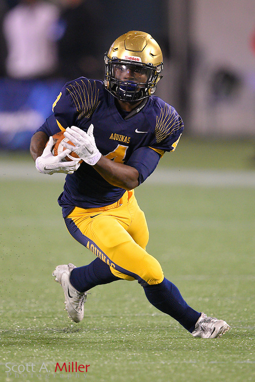 St. Thomas Aquinas running back Deltron Sands (4) during the Florida State High School Class 7A state championship game at the Citrus Bowl on Dec. 12, 2014 in Orlando, Florida.<br /> <br /> &copy;2014 Scott A. Miller