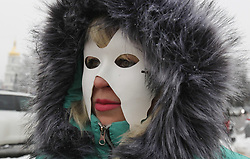 December 17, 2018 - Kiev, Ukraine - The sex workers with masks on their faces take part at their performance timed to the International Day to End Violence Against Sex Workers, at  St.Michael's Square in Kiev, Ukraine, 17 December, 2018. Protestors demand to pay attention to the observance of the human rights of sex workers, and protest against violence and discrimination against them.The International Day to End Violence Against Sex Workers mark on 17 December. (Credit Image: © Str/NurPhoto via ZUMA Press)