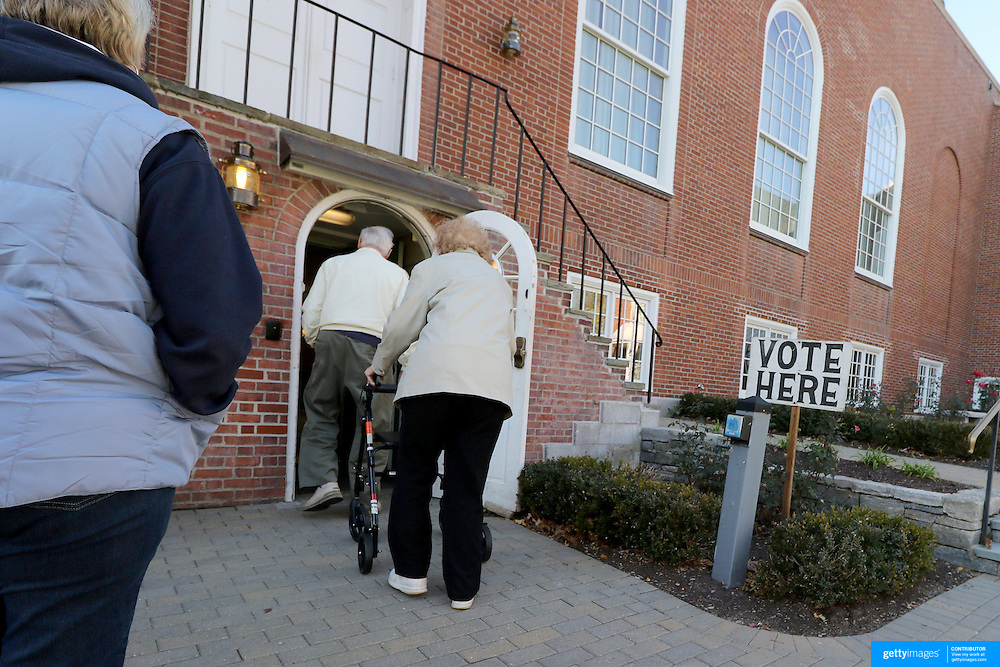 CLINTON, CONNECTICUT- NOVEMBER 08: Voters arrive at the Clinton Town Hall used for poling on election day in the coastal town of Clinton, Connecticut on November 08, 2016 (Photo by Tim Clayton/Corbis via Getty Images)