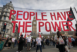 © Licensed to London News Pictures. 01/07/2017. London, UK. A see-through banner saying 'PEOPLE HAVE THE POWER' is held aloft outside Parliament during the People's Assembly anti-austerity demonstration. Photo credit: Peter Macdiarmid/LNP