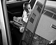 OT_282486_LYTT_LDDANI<br /> <br /> CAPTION:  (TAMPA, FL -- 02/03/2008) Even though the school bus stops right at her house, Dani's parents worry about her running into the road, so part of their routine is to have her sit in the back seat of a car, and they give her audio books and toys that make noise at the touch of a button to keep her occupied before heading off to school in the mornings.  (MELISSA LYTTLE | Times)<br /> <br /> STORY SUMMARY:  For the first seven years of her life, Danielle never saw the sun, felt the wind or tasted solid food.  She was kept in a closet in a Plant City apartment, cloistered in darkness, left in a dirty diaper, fed only with a bottle. &quot;She was a ferral child,&quot; said Carolyn Eastman of the Tampa heart Gallery. &quot;We'd never seen a case like that.&quot;