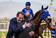 ARCADIA, CA - DECEMBER 30: Bing Bush hugs trainer Richard Baltas after pulling off the upset in the Robert Frankel Stakes with Midnight Crossing at Santa Anita Park on December 30, 2017 in Arcadia, California. (Photo by Alex Evers/Eclipse Sportswire/Getty Images)