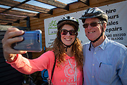 A man and women wearing cycling helmets smile as they take a selfie at the UK Electric Bike Centre in Staplehurst, Kent, England, UK.  (photo by Andrew Aitchison / In pictures via Getty Images)
