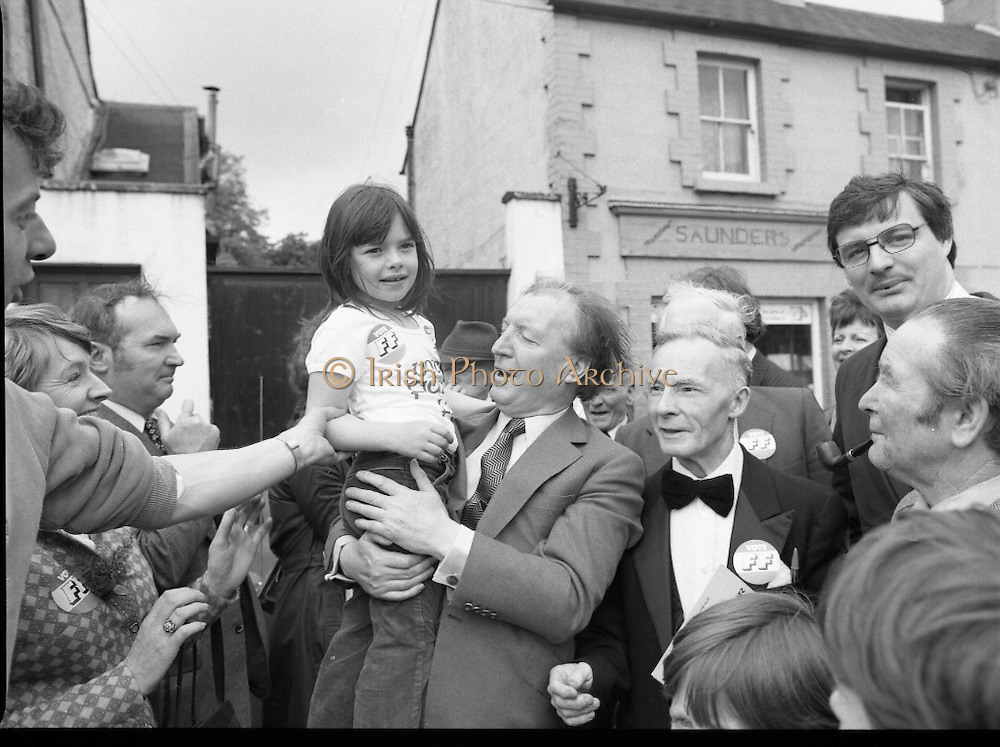 Taoiseach's Election Campaign.      (N77)..1981..23.05.1981..05.23.1981..23rd May 1981..On the 21st May the Taoiseach, Mr Charles Haughey, dissolved the Dáil and called a general election. Charles Haughey, Garret Fitzgerald and Frank Cluskey were leading their respective parties into a general election for the first time as they had only taken party leadership during the last Dáil..Fianna Fáil had hoped to call the election earlier, but the Stardust Tragedy caused the decision to be deferred...Image of Charles Haughey, Eileen Lemass and Liam Lawler on the campaign trail with supporters in Lucan. The child is Grainne Woods of Lucan.