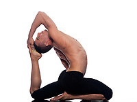 Man yoga Eka Pada Rajakapotasana pose One-Legged King Pigeon stretch gymnastic acrobatics  studio on white background