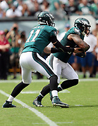 Philadelphia Eagles quarterback Carson Wentz (11) hands off the ball on a running play to Philadelphia Eagles running back Ryan Mathews (24) for a first quarter gain of 6 yards during the 2016 NFL week 1 regular season football game against the Cleveland Browns on Sunday, Sept. 11, 2016 in Philadelphia. The Eagles won the game 29-10. (©Paul Anthony Spinelli)