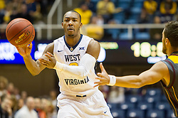 Nov 23, 2015; Morgantown, WV, USA; West Virginia Mountaineers guard Jevon Carter passes to a teammate during the first half against the Bethune-Cookman Wildcats at WVU Coliseum. Mandatory Credit: Ben Queen-USA TODAY Sports