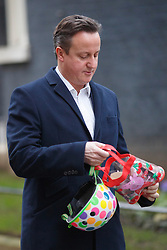 © licensed to London News Pictures. London, UK 21/01/2014. Prime minister David Cameron taking his daughter Florence (not pictured) to nursery before a cabinet meeting on Downing Street on Tuesday, 21 January 2014. Photo credit: Tolga Akmen/LNP
