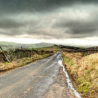 Country lane with stone walling over moorland in England