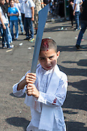 Young shiite muslim boy, with a bloody head wound, carrying a large traditional sword, commemorating the Day of Ashura, in Nabatieh, Lebanon (November 14, 2013).