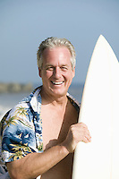 Middle-aged man holding a surfboard
