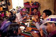 "The Mendoza kitchen in their home in  Todos Santos Cuchumatán, Guatemala, is the center of family life, and his wife's cooking unlocks the key to Fortunato's heart. ""I am happiest,"" Fortunato (at right, center) says, ""when I'm eating Susana's rice and beans, her homemade tortillas, and her turkey soup."" Hungry Planet: What the World Eats (p. 160)."