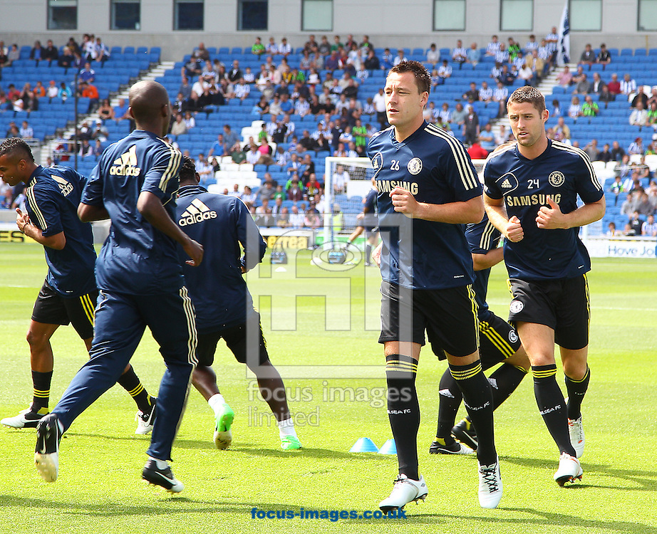 Picture by Paul Terry/Focus Images Ltd +44 7545 642257.04/08/2012.John Terry ( C ) and Gary Cahill ( R ) of Chelsea warm up before the Friendly match at the American Express Community Stadium, Brighton and Hove.