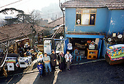 Çinar Family of Golden Horn (or Haliç) area, Istanbul, Turkey, with all of their possessions outside their home. The photograph was made by Peter Menzel and patterned after his 1994 book, Material World: A Global Family Portrait.