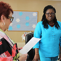 Patricia Ann Reece Howell takes her oath of office on the Aberdeen Housing Authority Board by its president, Ann Tackett. Howell was appointed to the seat formerly held by Doug Stone, who now serves at Ward 2 alderman.