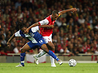 Photo: Chris Ratcliffe.<br /> Arsenal v FC Porto. UEFA Champions League, Group G. 26/09/2006.<br /> Thierry Henry of Arsenal clashes with Anderson of Porto.