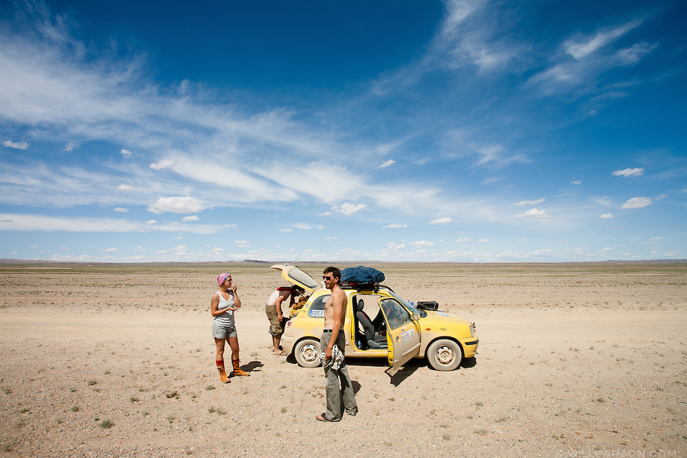 Bones Latham, Michael Kelly and Ryan Natan rotate drivers in Govi-Altai Province, Mongolia, along the northern edge of the Gobi Desert.