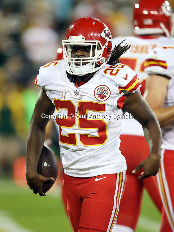 Kansas City Chiefs running back Jamaal Charles (25) celebrates after running for a 9 yard second quarter touchdown that cuts the Green Bay Packers lead to 17-7 during the 2015 NFL week 3 regular season football game against the Green Bay Packers on Monday, Sept. 28, 2015 in Green Bay, Wis. The Packers won the game 38-28. (©Paul Anthony Spinelli)